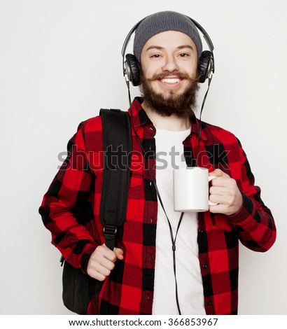 young bearded man with a cup of coffee - stock photo