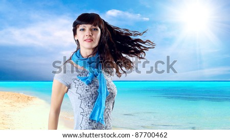 Young beatiful caucasian women with hair on the wind at sunny tropical beach - stock photo