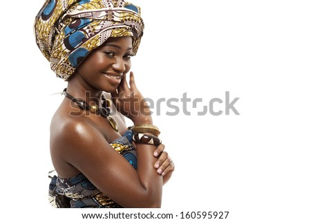Young beautiful African fashion model in traditional dress. - stock photo