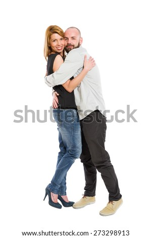 Young, beautiful and happy couple hugging each other on white background - stock photo