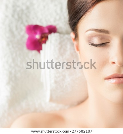 Young, beautiful and healthy woman in spa salon. Traditional oriental massage therapy and beauty treatments.  - stock photo