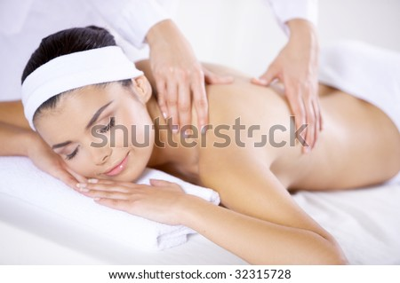 Young beautiful and relaxed taking spa treatment - stock photo