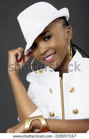 Young Beautiful and Smiling African Woman Posing, Fashion, Studio Shot, on Grey Background - stock photo