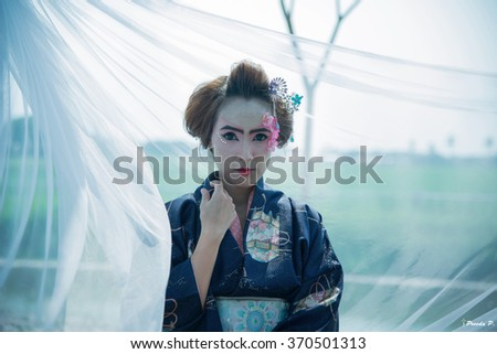 Young beautiful asian woman's portrait, geisha in kimono  - stock photo