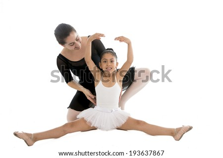 young beautiful ballerina dancing and learning from her dance teacher on a white background. - stock photo