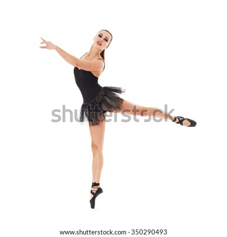 Young beautiful ballet dancer posing on a studio - stock photo