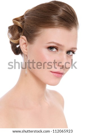 Young beautiful blond girl with prom make-up and hairdo, over white background - stock photo