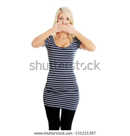 Young beautiful blond woman covering her mouth with hands, isolated on white background. Freedom of speech concept - stock photo