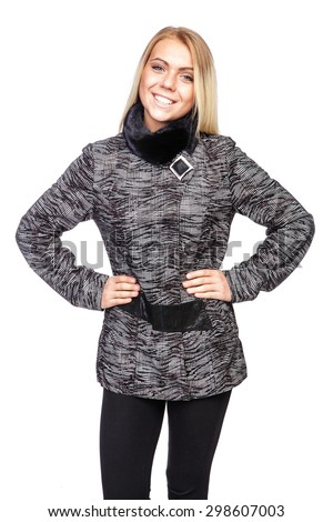 Young beautiful blond woman in a black and white plaid coat - stock photo