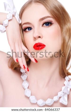 Young beautiful blond woman with glamorous make-up - stock photo