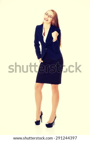 Young beautiful blonde businesswoman cheering - stock photo