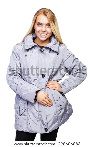 Young beautiful blonde girl in a gray jacket with a zipper  - stock photo