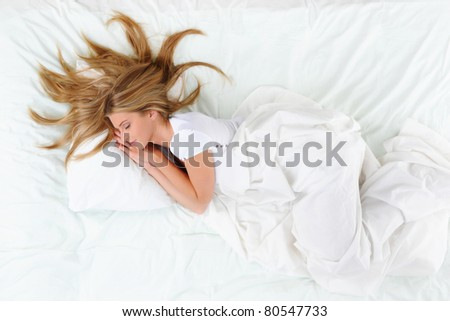 young beautiful blonde woman on the bed - stock photo