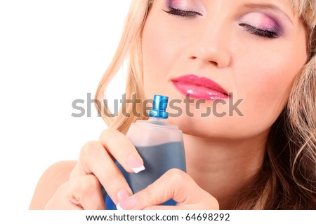 Young beautiful blonde  woman with bottle of perfume isolated on white background - stock photo