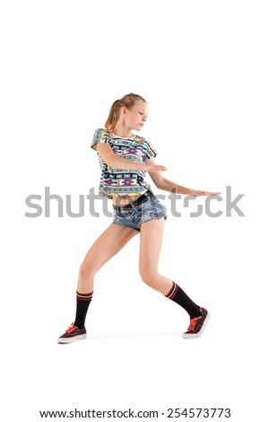 young beautiful booty dancer posing on studio background - stock photo