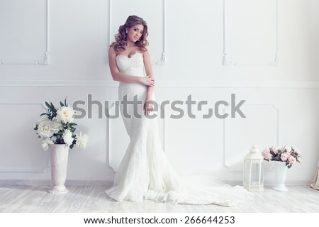 Young beautiful bride in antique interior - stock photo