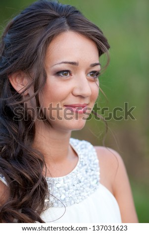 Young beautiful bride in white dress on nature - stock photo