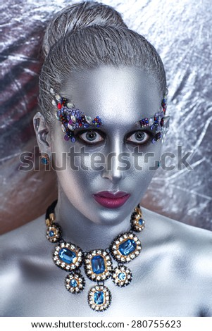 Young beautiful, bright, showy girl, lady, model, dancer queen. Fairy tale, future, party, disco, techno, club. Art makeup, flawless face, silver eyes cheeks eyebrows, lips. Forehead, mask, hair dress - stock photo