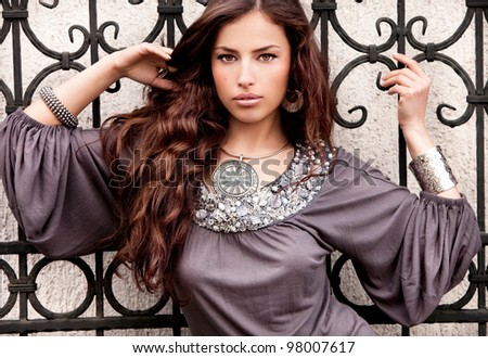 young beautiful brunette woman, outdoor portrait - stock photo