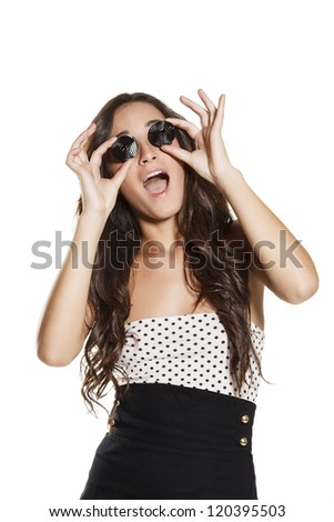 young beautiful brunette woman with candy on eyes, open mouth. on white background - stock photo