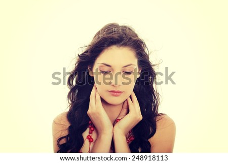 Young beautiful brunette woman with red necklace. - stock photo