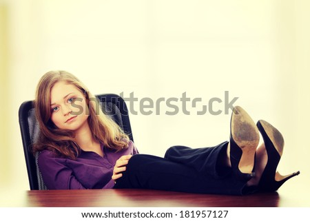 Young beautiful business lady having a rest at the working place.   - stock photo