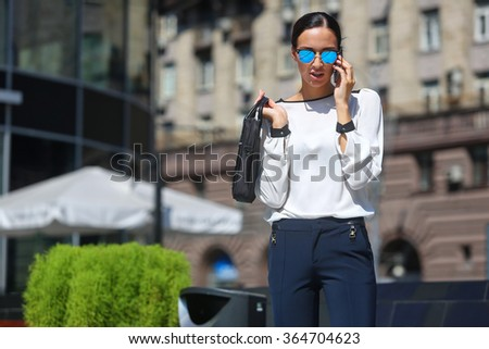 Young beautiful business woman calling by phone - stock photo