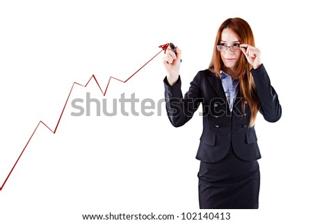 Young beautiful  business woman drawing a virtual business graphic - stock photo