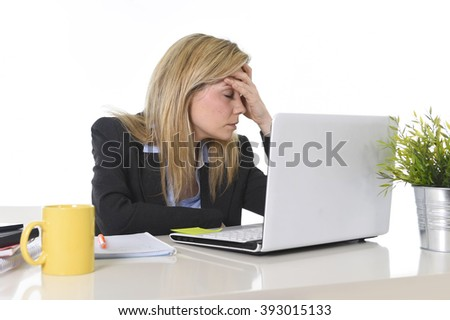 young beautiful business woman suffering stress working at office computer desk feeling tired and desperate looking overworked covering face with hands overwhelmed and frustrated - stock photo