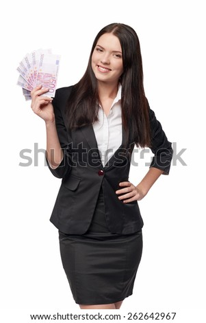 Young beautiful business woman with euro money in hand - stock photo