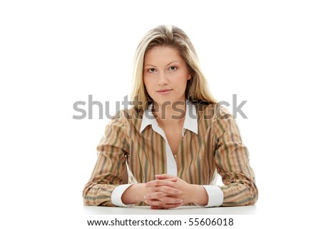 Young beautiful businesswoman behind the desk, isolated - stock photo