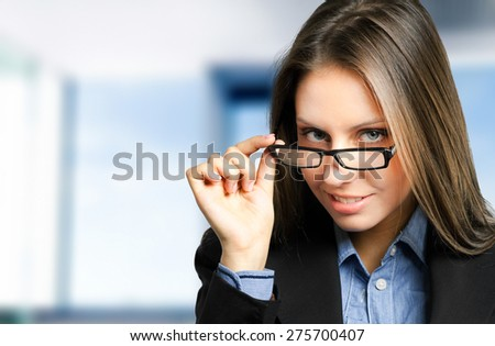 Young beautiful businesswoman holding her glasses - stock photo