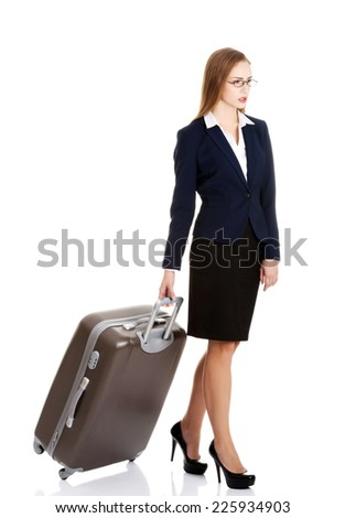 Young beautiful businesswoman holding travel bag - stock photo