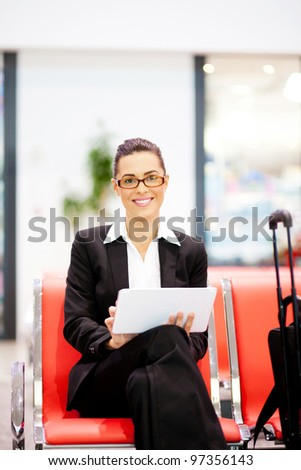 young beautiful businesswoman using tablet at airport - stock photo