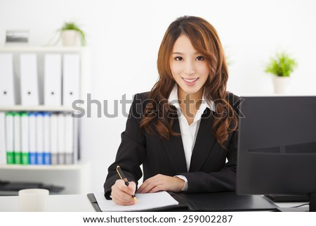 young beautiful  businesswoman working in the office - stock photo