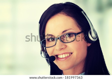 Young beautiful call cener worker - stock photo