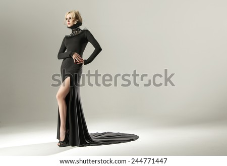 young beautiful caucasian blonde in gorgeous dress - stock photo