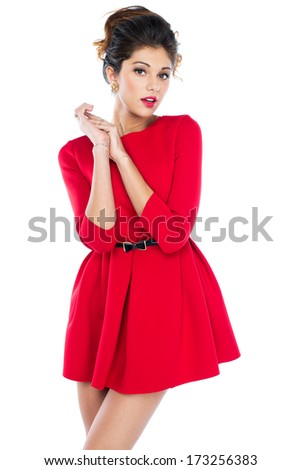 Young beautiful caucasian brunette in fashion red gown posing on white background - stock photo