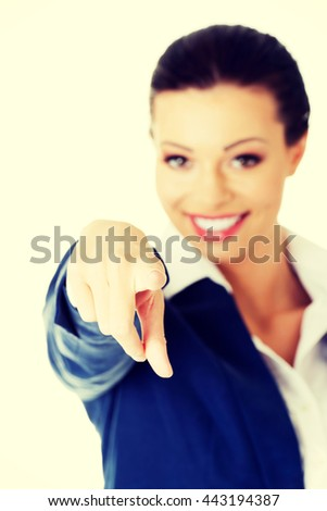 Young beautiful caucasian business woman pointing on you - stock photo