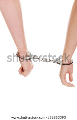 Young beautiful caucasian couple handcuffed. - stock photo