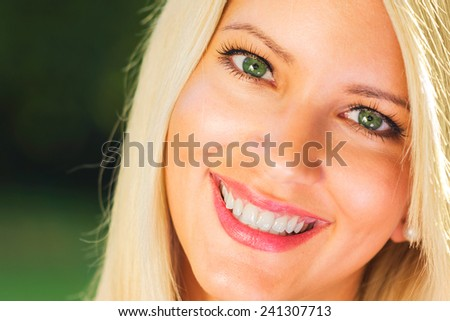 Young beautiful Caucasian female model with healthy teeth - stock photo