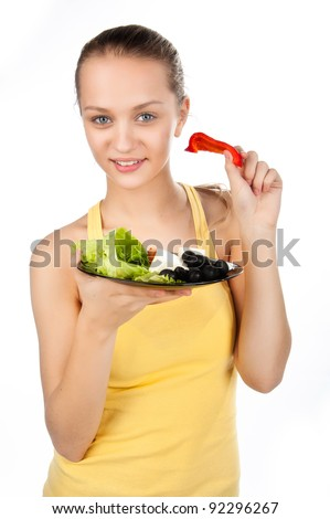 young beautiful caucasian woman eating vegetable  Greek salad, vegetable salad and a girl, healthy eating, girl holding plate with salad, isolated on white background - stock photo