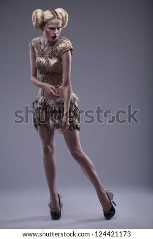 young beautiful caucasian woman in gorgeous dress - stock photo