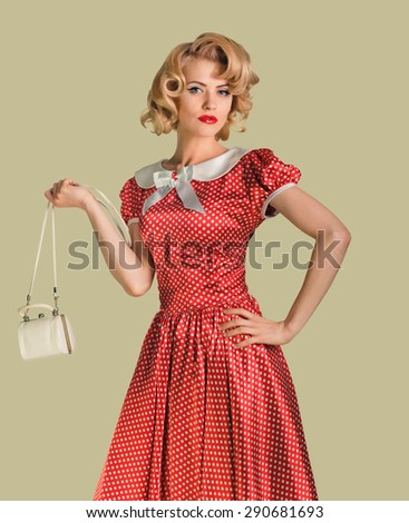 young beautiful caucasian woman posing with purse, over dirty yellow background, retro styling, pin up - stock photo