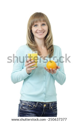 Young beautiful Caucasian woman with blue eyes waist up studio shot on white background (isolated). Looking at camera and smiling. Holding a glass of orange juice and orange. - stock photo