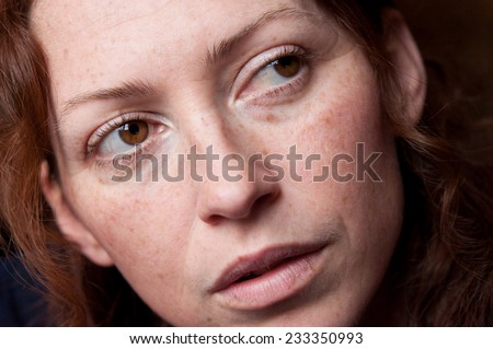 young beautiful caucasian woman without makeup brown eyes looking back - stock photo