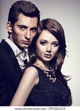Young beautiful couple at studio - stock photo
