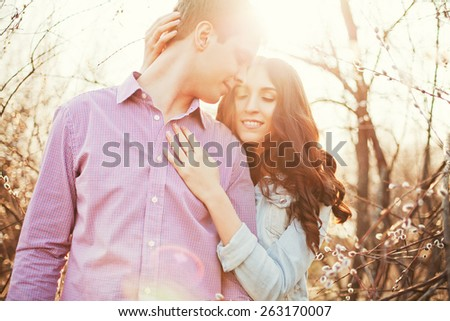 young beautiful couple at sunset - stock photo