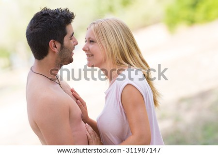 young beautiful couple embracing, selective focus - stock photo