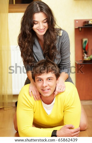 Young beautiful couple having fun at home - stock photo